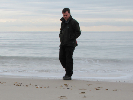 Roy Shepherd fossil hunting on the beach at Barton on Sea