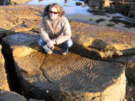 Lucinda Shepherd and prehistoric ripple marks preserved in the exposed rock