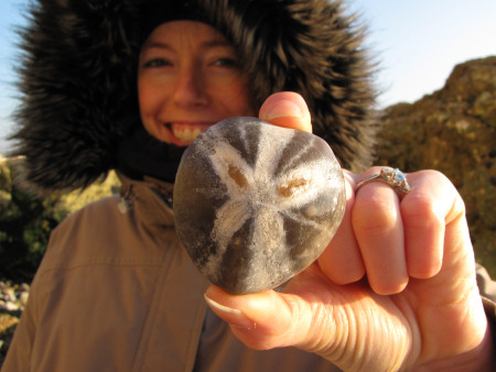 Lucinda Shepherd with a fossil Micraster echinoid at Seaford Head