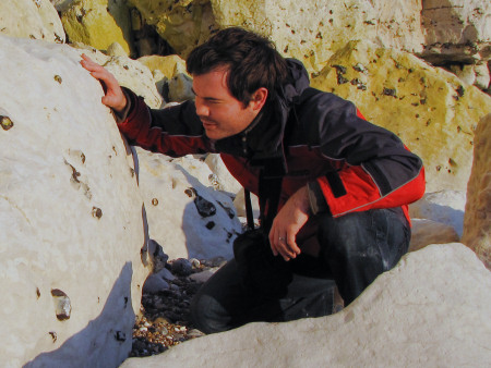 Roy Shepherd examining a chalk boulder for fossils at Seaford Head