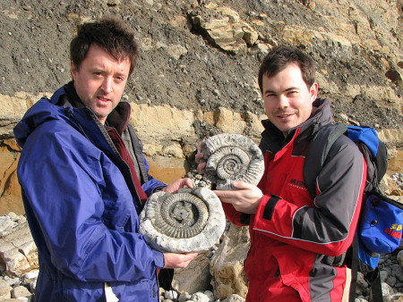 Andrew Holmes and Roy Shepherd with fossil ammonites